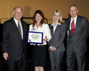 ESOP Association president J. Michael Keeling presents the ESOP Company of the Year award to Burns & McDonnell, accepted by Melissa Wood, Vice President of Human Resources; Polly Whitaker, Benefits Manager; and John Walter, Internal Communications Manager